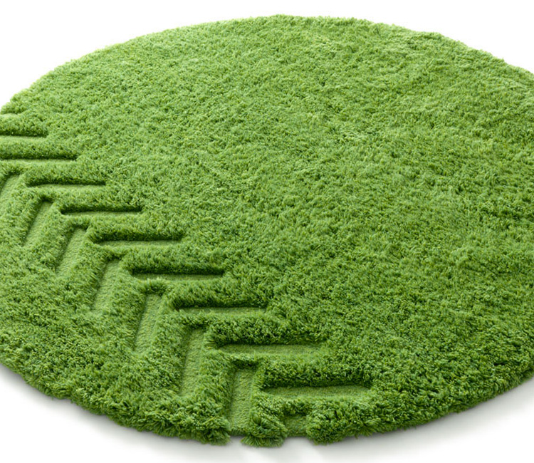 grass with tractor tire mark area rug