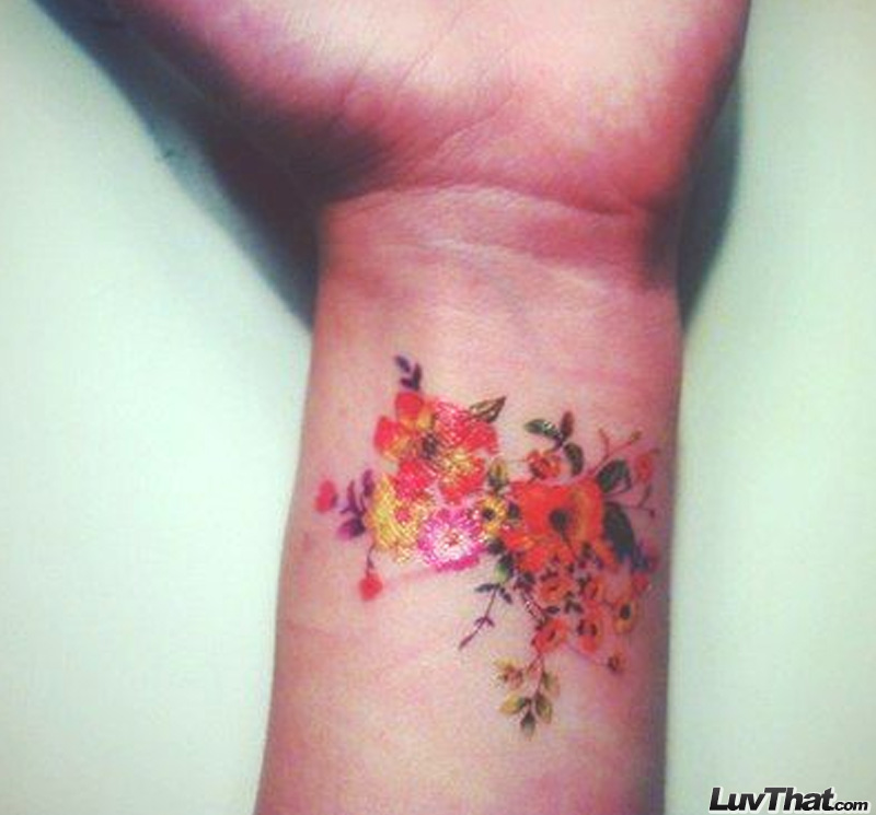colorful flowers wrist tattoo