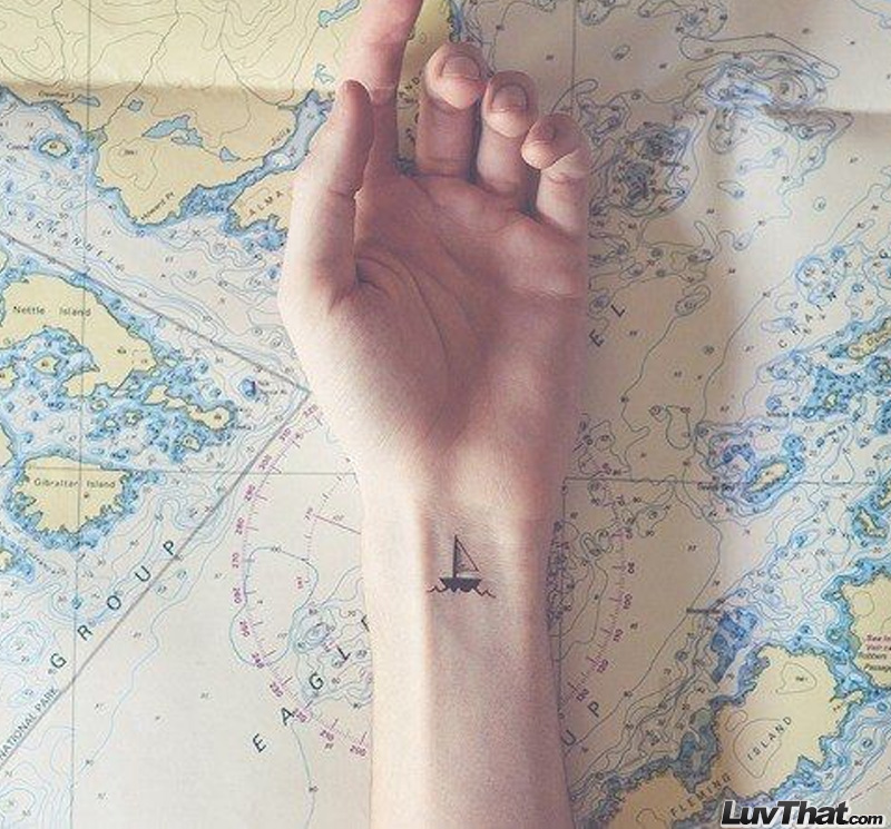 cute little sail boat wrist tattoo