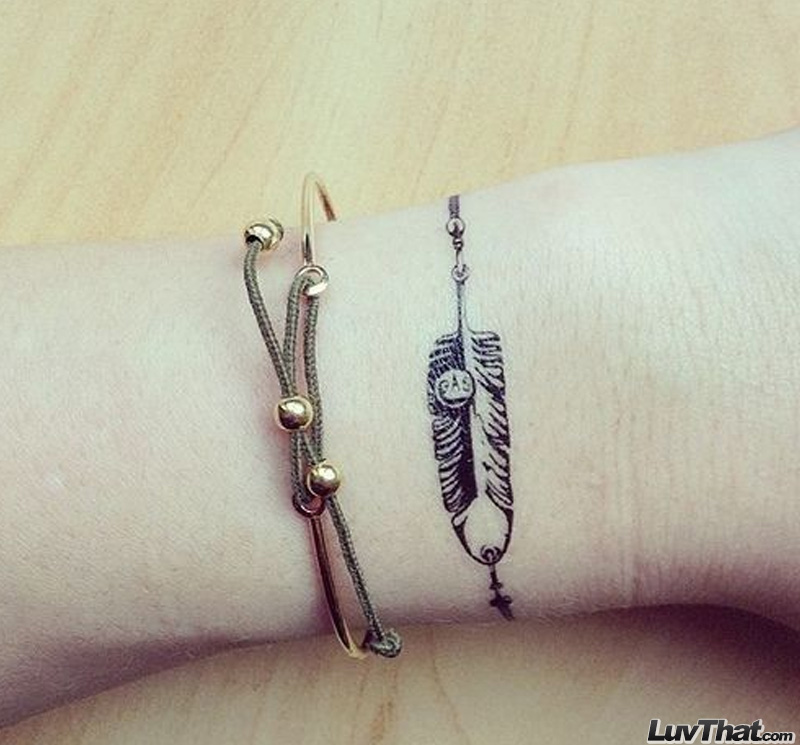 feather wrap around wrist tattoo