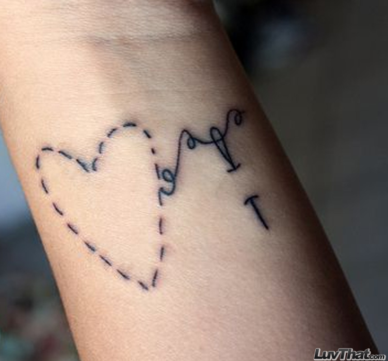 needle stitched heart wrist tattoo