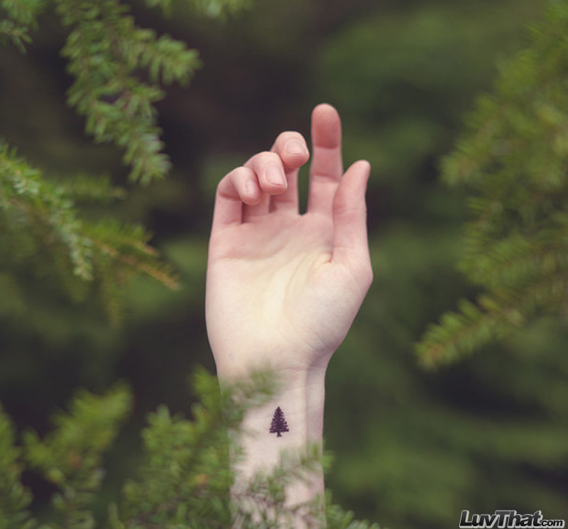 pine tree wrist tattoo