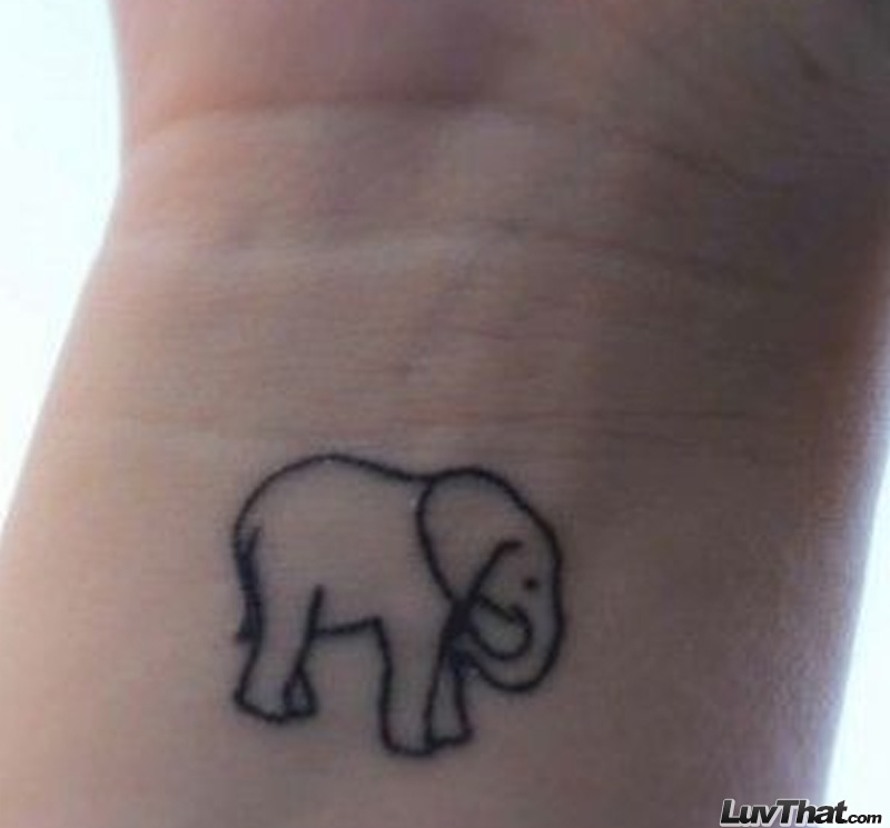 tiny elephant wrist tattoo