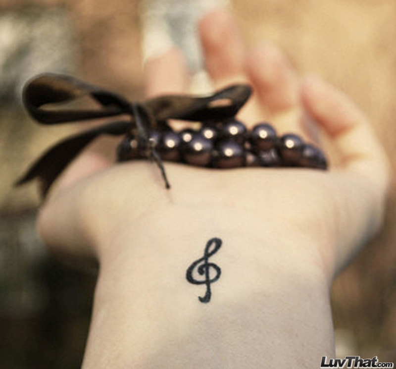 trebble clef wrist tattoo