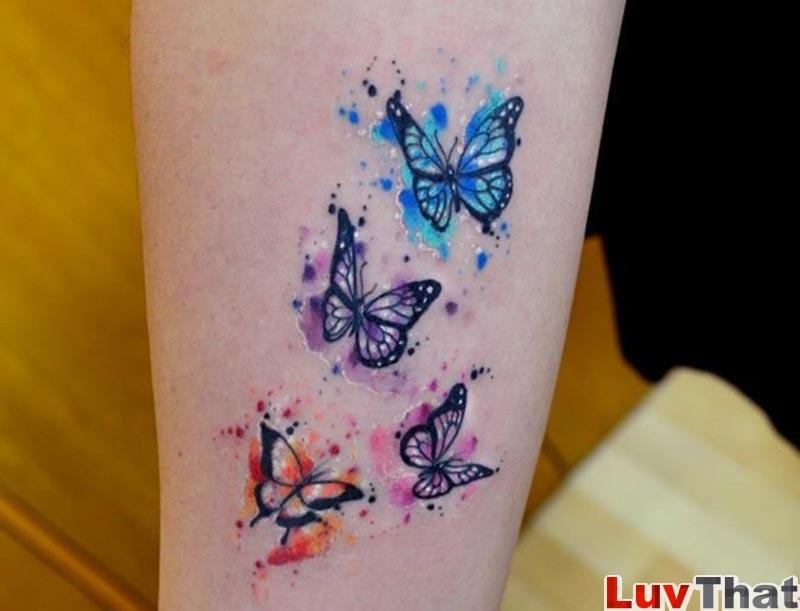 blue purple pink orange butterflies tattoo