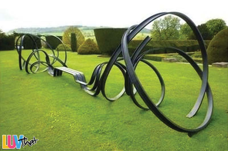 curved i-beam sculpture and bench