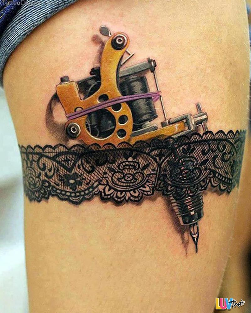 beautiful lace garter and tattoo gun tattoo